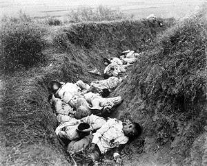 """U.S. Army photo: """"Insurgent dead just as they fell in the trench near Santa Ana, February 5th 1899. The trench was circular, and the picture shows but a small portion."""""""