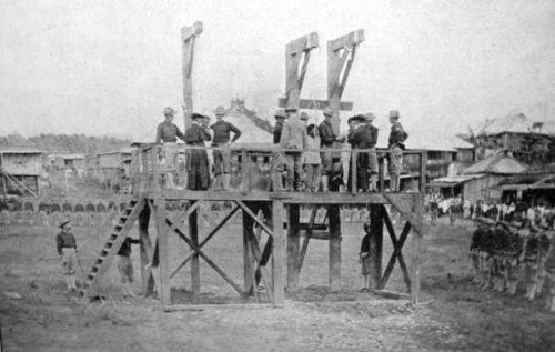 """Three """"Ladrones"""" (bandits) are about to be hanged in Tayabas Province (now Quezon). The Brigandage Act of 1902 passed on November 12, 1902 interpreted all acts of armed resistance to American rule as banditry. PHOTO was taken in the early 1900s."""