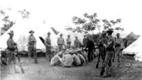 """Filipino POWs in Nasugbu, Batangas Province When an American was """"murdered"""" in Batangas,  Bell ordered his men to """"by lot select a POW--preferably one from the village in which the assassination took place--and execute him."""""""