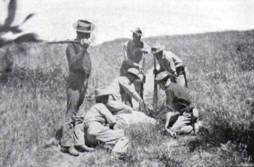 """US soldiers administering the """"water cure"""" to a Filipino  """"insurgent"""".  This cure was repeated until the prisoner talked or died. Roughly half the Filipinos given the cure did not survive. How many Filipinos were killed by torture is not known, but the extent of the practice is documented by a letter sent home by a soldier who bragged of inflicting the water cure on 160 Filipinos, 134 of whom died. A Harvard-educated officer, 1st Lt. Grover Flint, testified before the US Senate on the routine torture of Filipino combatants and civilians. He described the """"water cure"""" as standard US Army torture."""
