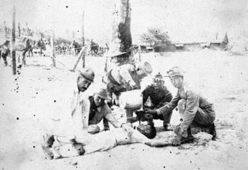 """American soldiers """"water cure"""" a Filipino. Maj. Gen. Adna R. Chaffee, military governor of the """"unpacified areas"""" of the Philippines, 1901-1902,  ordered the US Army to """"Obtain information from natives no matter what measures have to be adopted."""""""