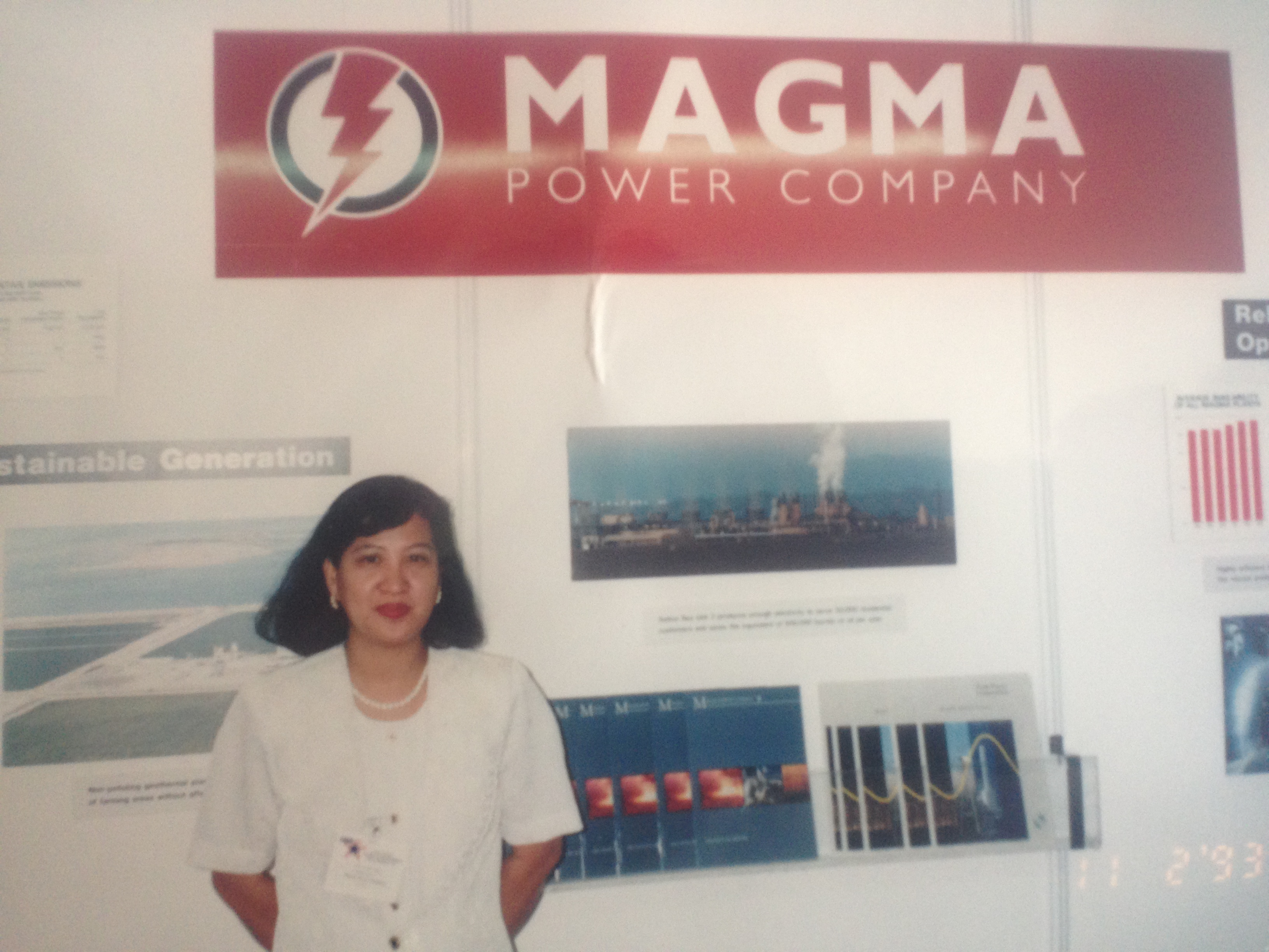 Elena G. Macario in the 1993 Energy Exposition in Manila, manning the booth of Magma Power Company. During the exhibition, US Ambassador John Negropointe visited Magma Power's booth and even posed for a photo with Elena.
